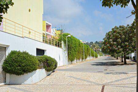 region of algarve: Colorful modern apartment blocks and street, Portugal Algarve Region Stock Photo