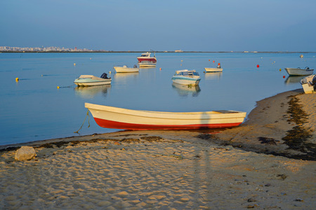 Photo of boats in bay at sunset in Portugal photo
