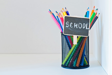 copyspace: Pencils in a holder on the light-coloured shelf with copy-space Stock Photo