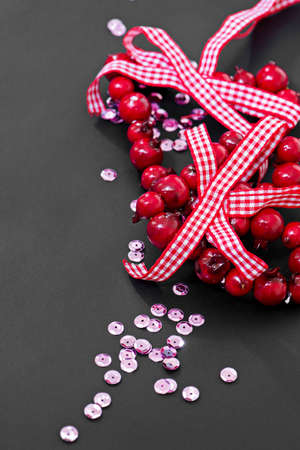 sequins: Christmas decoration and pink sequins on dark background Stock Photo