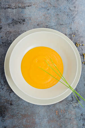naranja color: View from above to the delicious healthy pumpkin cream soup