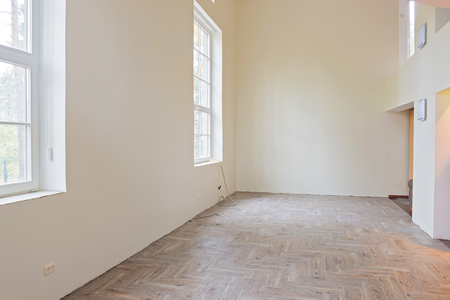 wooden floors: New home construction interior living room with unfinished tile wooden floors, big windows and balcony.