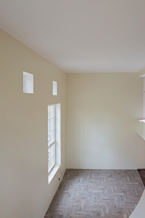 wooden floors: Interior of unfinished living room with tile wooden floors and big windows. View from balcony.