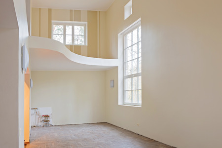 wooden floors: New home construction interior living room with unfinished tile wooden floors, big windows and balcony