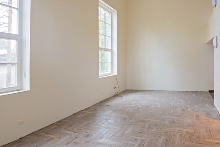 wooden floors: New home construction interior living room with unfinished tile wooden floors and big windows