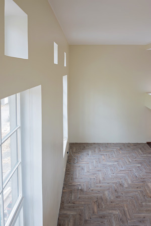 wooden floors: Interior of unfinished living room with tile wooden floors and big windows Stock Photo