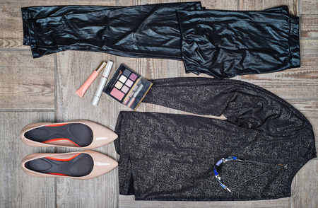 overhead view: Overhead view of females fashion with accessories on wooden background