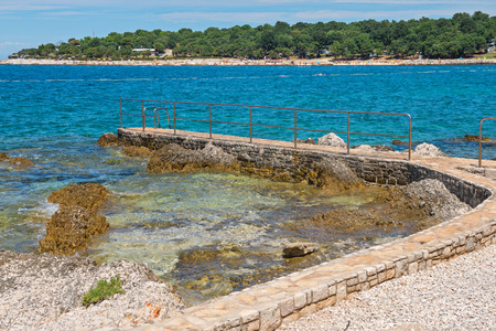 Rocky beach and bue sea in Istria, Croatian coast