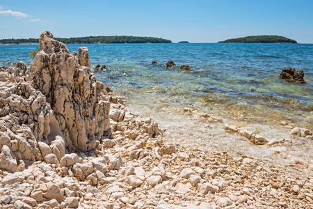 Rocky beach, bue sea and islands in Istria, Croatian coast