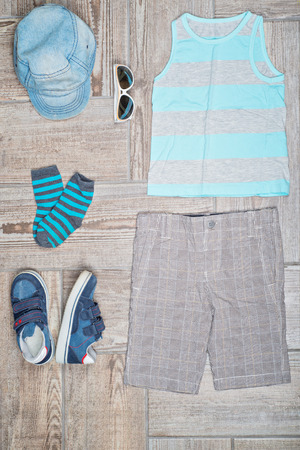 Flat lay photography of boys casual outfit.