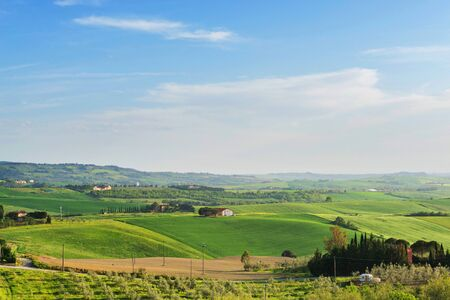 Beautiful spring evening froggy landscape in Tuscany