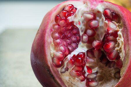 Macro shooting of fresh juicy pomegranate grains