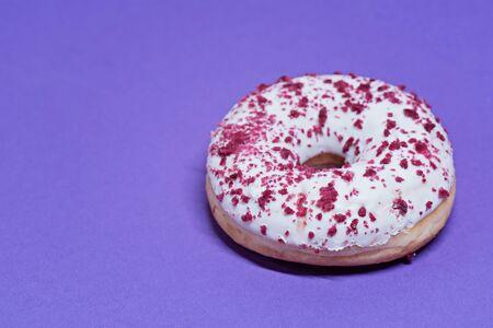 Macro shoot of white donut over blue background Reklamní fotografie