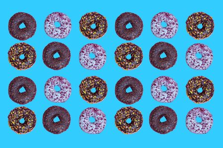 Top view to the donuts over blue background