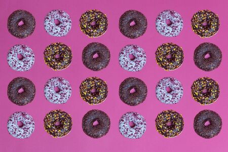 Top view to the donuts over pink background 스톡 콘텐츠