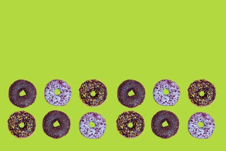 Top view to the donuts over green background
