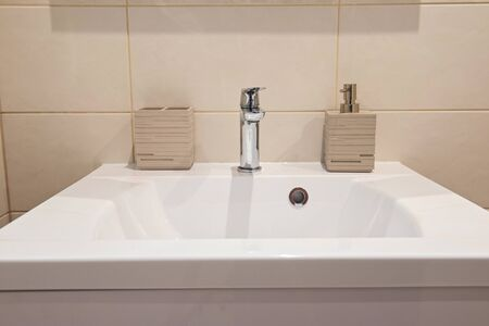 Bathroom interior with sink and faucet in apartment