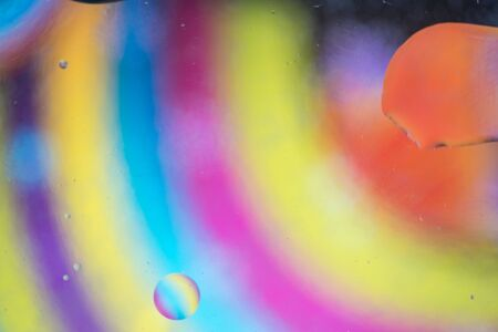 Oil drops in water. Abstract psychedelic pattern image rainbow colored. Abstract background with colorful gradient colors.