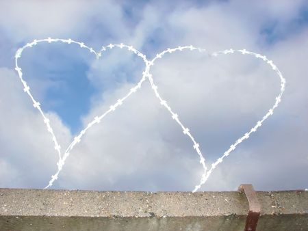 Two hearts of barbed wire. Established on a concrete fence  photo