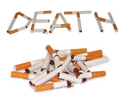 A heap of broken cigarettes. And the word, laid with a broken cigarette Stock Photo - 6918882