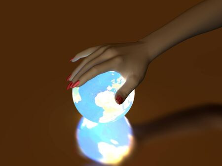 The hand rests on a bright ball, designed with a globe Stock Photo - 7005970