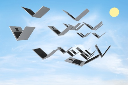 Open laptops are flying like a bird against the blue sky. Concept render Stock Photo - 9622727