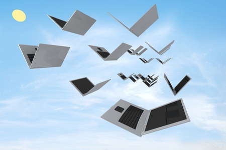 Open laptops are flying like a bird against the blue sky. Concept render Stock Photo - 10309090