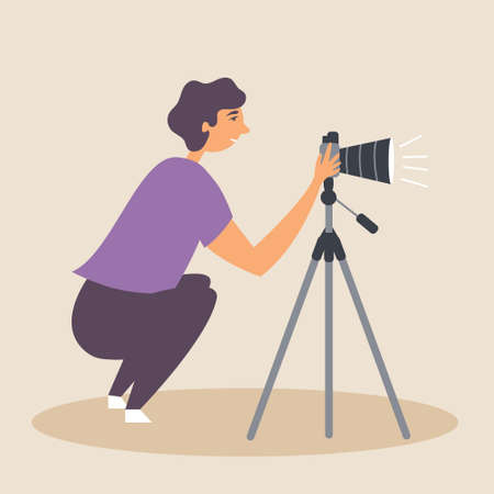 The half-sitting guy takes a photograph using a SLR camera on a tripod in a natural environment. Photographer. Editable Vector Illustration