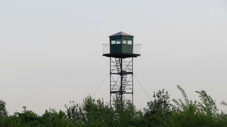 state boundary: Lookout military tower on the border Stock Photo