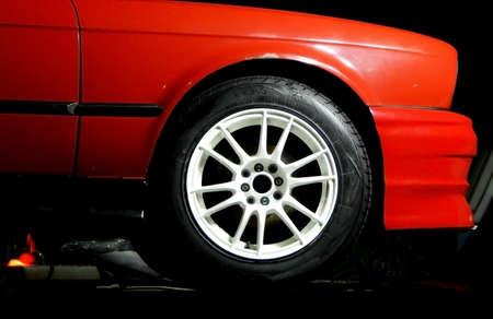 custom car: Custom white wheel on the sport car