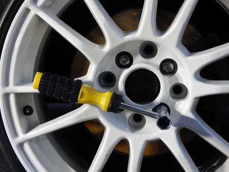 custom car: Cross wrench inside wheel at mounting custom car rim