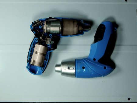 disassembled: Disassembled electric screwdriver cutaway studio shot Stock Photo