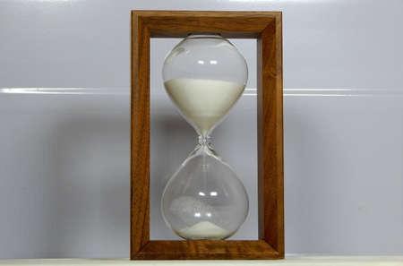 sandglass: Sandglass over white background studio shot Stock Photo