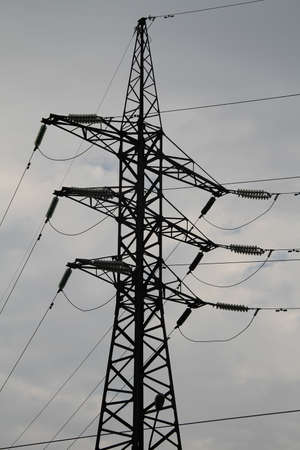 amperage: Pylon and wires of high voltage power line over sky