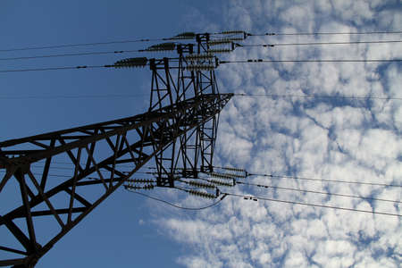 power delivery: Pylon and wires of high voltage power line over sky
