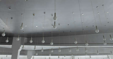 market bottom: Round ceiling lamps on wires at the lighting store