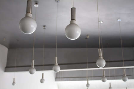 market bottom: Lighting design. Round lamps on cords in lights shop Stock Photo