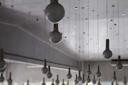 ceiling lamps: Round ceiling lamps on wires at the lighting store