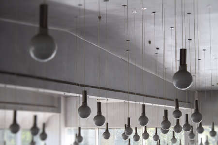 ceiling lamps: Round ceiling lamps on wires at the television studio Stock Photo