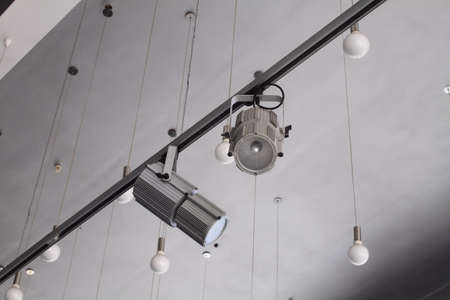 market bottom: Lighting technology in studio with moving track spotlights and ceiling lamps