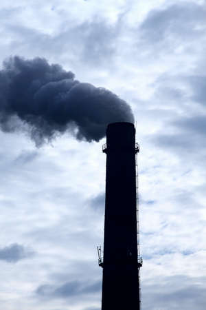 smokestack: Toxic clouds of smoke from industrial smokestack pollutes the air Stock Photo