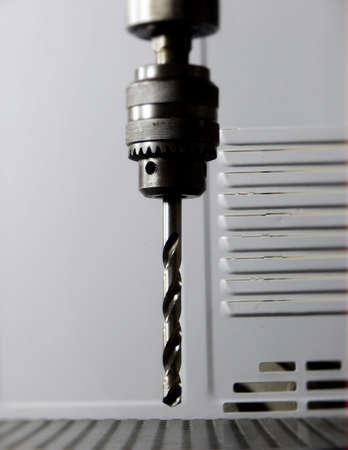 drilling machine: Head of drilling machine with metal drill bit
