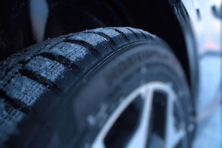 tire tread: Non studded winter tires and snow between protectors closeup