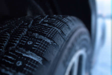 winter tires: Studded winter tires and snow between protectors detailed