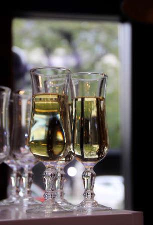 ber: Glasses of white wine on the bar at restaurant