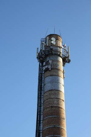 smokestack: Radio location system on the top of old smokestack Stock Photo