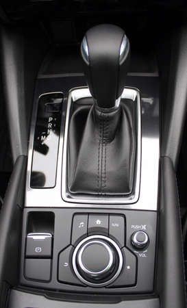 shift: Leather upholstery of gear shift knob inside the car