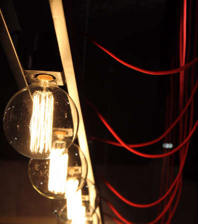 switched: Switched electric bulbs and red wires in the darkness