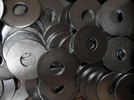 metalware: Hardware shop. Washers closeup texture background