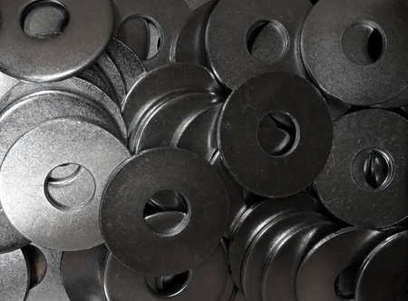 metalware: Hardware products. Iron washers texture background